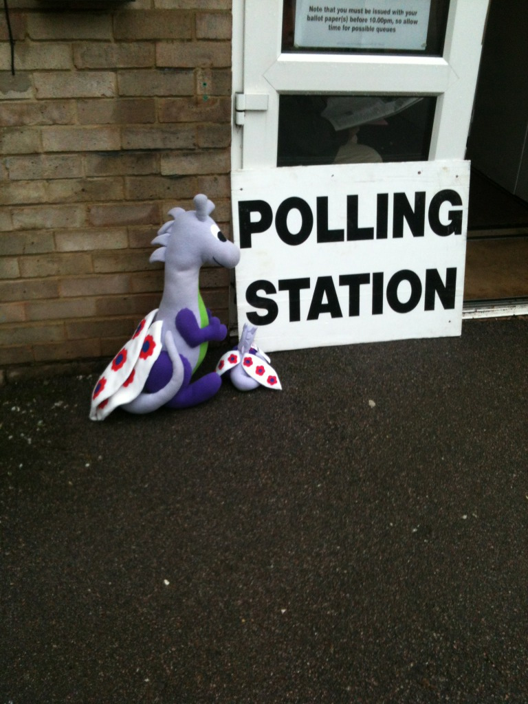Puffles with a baby dragon fairy outside a polling station in 2012