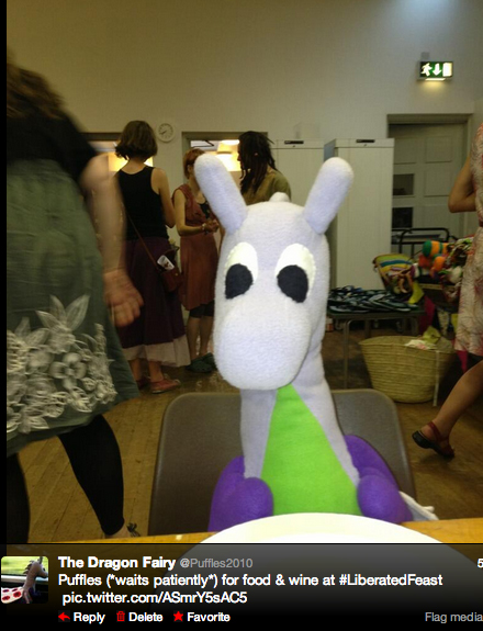Puffles waits patiently for food and wine to be served