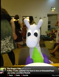 Puffles waits patiently for food and wine to be served at July's Liberated Feast