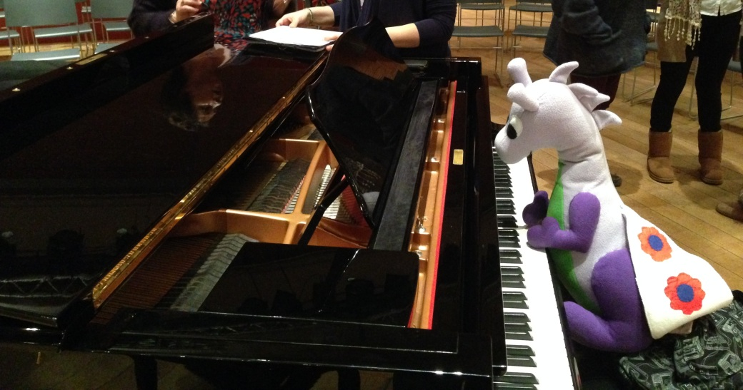 Puffles (*jumps*) to the grand piano at the Apex Centre in Bury St Edmunds