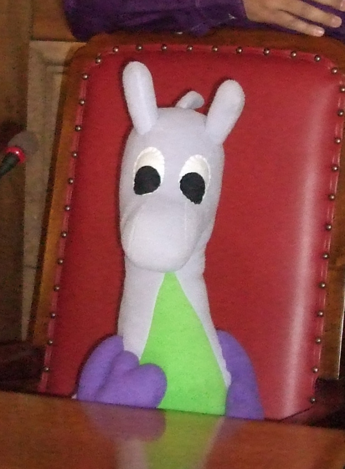 Puffles the dragon fairy occupying the Mayor of Cambridge's throne in one of the Guildhall's committee rooms.