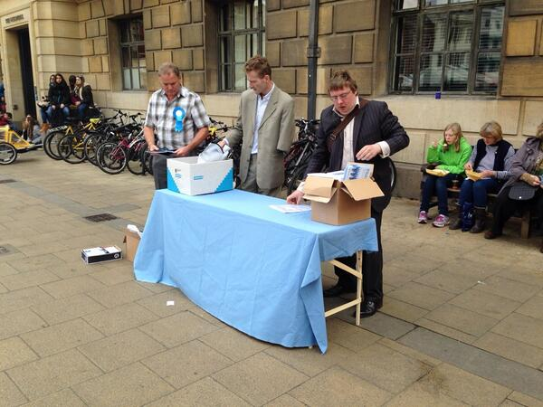 Tim Haire and Nick Clarke setting up their stall outside the Cambridge Guildhall following the launch of their manifesto