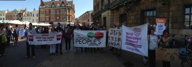 Campaigners from the local GMB trade union branch, Cambridge People's Assembly and the WDM Cambridge protesting against #TTIP